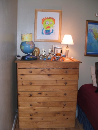 """Asperger bedroom makeover, My 12-year-old son has a form of autism called Asperger's Syndrome.  I felt that his old bedroom was too over stimulating for him so I did a mini-makeover to make it more serene and calm feeling.  He loves it.  His dad built the dresser when Jake was a baby so of course it has to stay.  The drawing is Jake's interpration of  """"The Scream.""""  The sword above the window is from his grandfather a captain in the Marine Corps (two tours in Vietnam).  It's a nice little room....very personal., the scream , Boys' Rooms Design"""