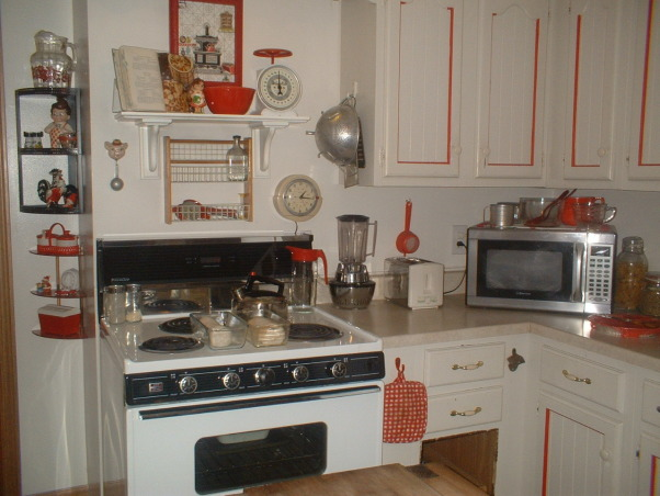 "My Retro 50's Vintage Red & White Kitchen, The basic white neutral kitchen...turned 1940's & 50's Red& White ""Blast from the past"". Fun and inviting! From cookbooks to utensils this kitchen really changes your mood! most itema were bought on ebay and at thrift stores. It is an ongoing project!, The old stuff works the best!, Kitchens Design"
