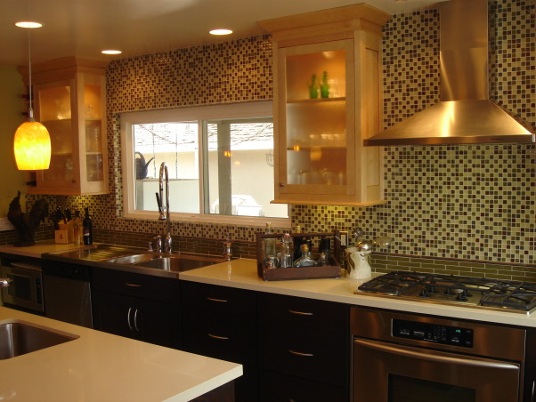 Double Take - A Transitional Kosher Kitchen, When my client approached me to design her kitchen only two things mattered 1) she wanted something that was somewhere in between traditional and contemporary [easy enough] and 2) it had to be a kosher kitchen [interesting].  Two-toned cabinets engineered stone countertops sleek stainless steel appliances and a sparkling blend of glass and metal tiles for the backsplash set up a beautiful palette for a hardworking kitchen where form had to follow function.  www.markbrownleedesign.com, In a kosher kitchen the preparation areas are separated into 3 distinct zones: meat dairy and parve (neutral ingredients).  Each zone typically has it's own dedicated cooktop oven microwave sink and dishwasher.  Using contrasting cabinetry glass and metal tiles for the backsplash and a simple colored countertop we were able to inject some unexpected fun with the lighting over the island.  www.markbrownleedesign.com, Kitchens Design