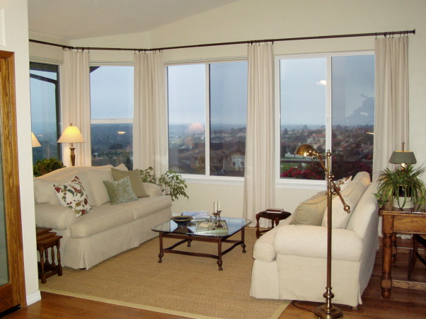 Rooms with a View, Living Room and Added Sun Room  , The two windows were added to maximize views and the wood floors were added.   All the furniture is recycled (used) and our budget for this room and the sunroom is less than $4000.00, Living Rooms Design