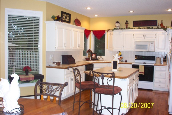Mustard Yellow Kitchen, Eventually we'd like to install granite counters and new backsplash that is not such a harsh white color but of course the budget thing............... CONSTRUCTIVE critisisms and comments welcomed :), Kitchens Design