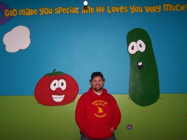 "Veggie Tales Nursery, First baby's nursery! We aren't finding out the sex of the baby until we meet him/her for the first time. We loved the idea of a ""christian"" themed nursery but aren't big fans of Noah's Ark decor so...Veggie Tales it is , The artist and his creation!!!This wall will have the black crib between Bob the Tomato and Larry the Cucumber., Nurseries Design"