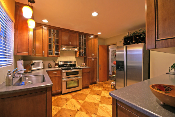 Wow Factor Floor,  kitchen was 1950's .  We added cabinets to ceiling height w/glass insert accent doors  s.s  appliances & exposed a pine sub-floor. which we scored  and stained . Added recessed lighting Corian counter  wine rack  , kitchen after, Kitchens Design