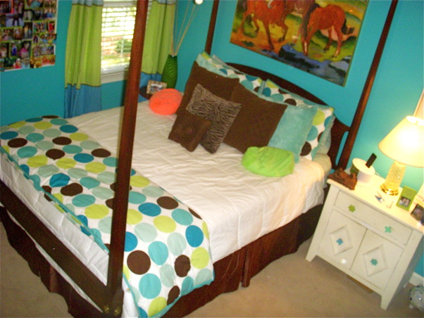 16 year old's bedroom. UPDATED PICTURES!, I redid my room for my 15th birthday. The walls are painted teal (biscay lightened 1 or 2 shades) with a strip of brown above my shelf on one wall. The polka dot comforter is from Target. I ride horses and love them so that really shows through my room like the painting above my bed & my horse frame! My mom & I made my jewelry/ purse boards. My closet doors are completely covered with pictures & words cutout from magazines...I know its pretty crazy but what can i say i'm a teenager!, having the white and polka dot comforters both on my bed was wayy too hott for summer so i folded the polka dot comforter and put it on the end of my bed. i actually kind of like it this way better anyways!, Girls' Rooms Design