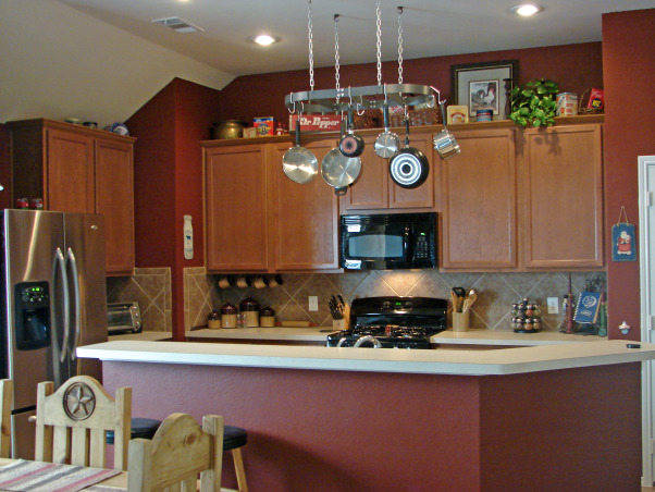Dr. Pepper kitchen, Based around the theme of Dublin Dr. Pepper home of the 'Pepper' this kitchen was painted red to match the already acquired memorabilia.   To those inquiries...  its a 'Burnished Mahogany' (Behr- Home Depot paint)  satin sheen finish.  : ), , Kitchens Design