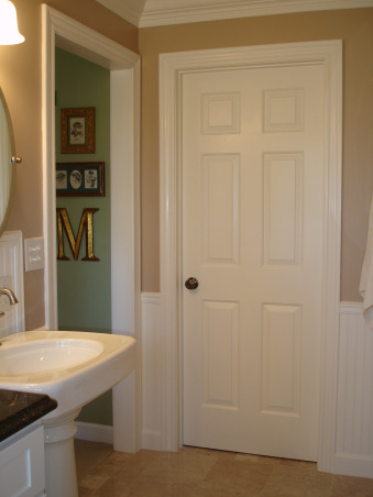 New Master Bath Reno...FINALLY COMPLETE!, Our master bath consists of two rooms. One room with tub and sink next room with shower and toilet. Originally (last picture) we had a huge garden tub and a long vanity with only one sink plus carpet. That room did not function well for us. We found a wonderful and talented carpenter/contractor in the Quincy IL area named Trent Mountain. He made our dreams come true with this new master bath. Double pedestal sinks claw foot tub cabinets granite top pocket door and marble floor!, View of doorway from master bedroom and walk in closet door., Bathrooms Design