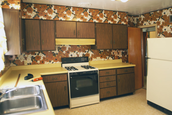Wow Factor Floor,  kitchen was 1950's .  We added cabinets to ceiling height w/glass insert accent doors  s.s  appliances & exposed a pine sub-floor. which we scored  and stained . Added recessed lighting Corian counter  wine rack  , , Kitchens Design