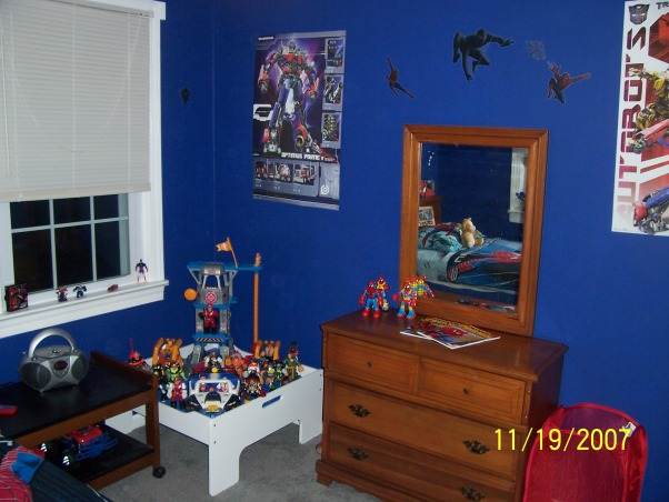 Spiderman room, My little firefighter grew up and passed his room down to my youngest. I had to create him a big boy room with a spiderman theme as requested by him. What started out as his nursery now has grrown with him into a big boy room he is very proud of. Hope you like it. By the way i did the complete transformation in 1 day while he was at school and finished exactly 7 minutes before he got home. Wheeew close., its sort of a small room but its big to a 4 year old., Boys' Rooms Design