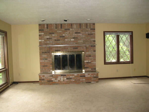 how to update brick fireplace?, I would appreciate any suggestions how to update our 80s fireplace or how to decorate around what I have.  I've considered painting or refacing to lighten it up.  Putting drywall over the top part etc. Also considering lightening all of our wood trim.  , view from adjoining dining room, Living Rooms Design