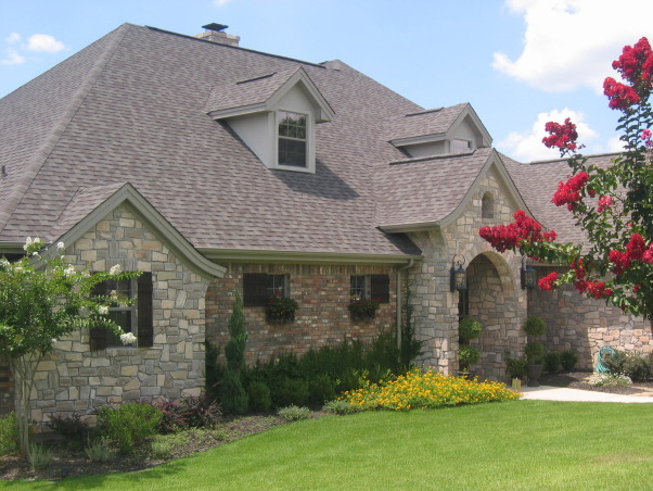 Stone and Brick Mix, I am not sure what style my home is considered to be but we were going for a European look. Hopefully it has that effect.  I think when the vine grows it will look more lush and cottage like., , Home Exterior Design