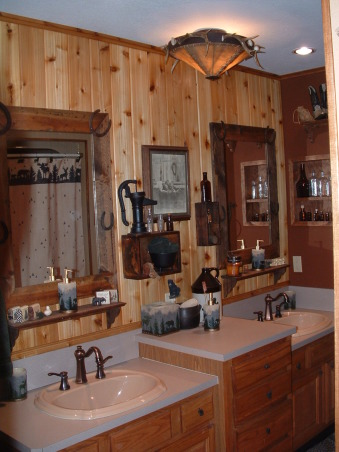 Modern Outhouse, This guest bathroom was bright cotton candy fuscia and really dull gray and woodtone mica when we moved in.  We are dreaming of the day we move to the mountains but thought we could bring some of it home now. My husband made the mirrors and did all of the woodwork on the walls. Friends and family love being using our modern outhouse when they visit.  We created the guest bedroom with the same feel. , , Bathrooms Design