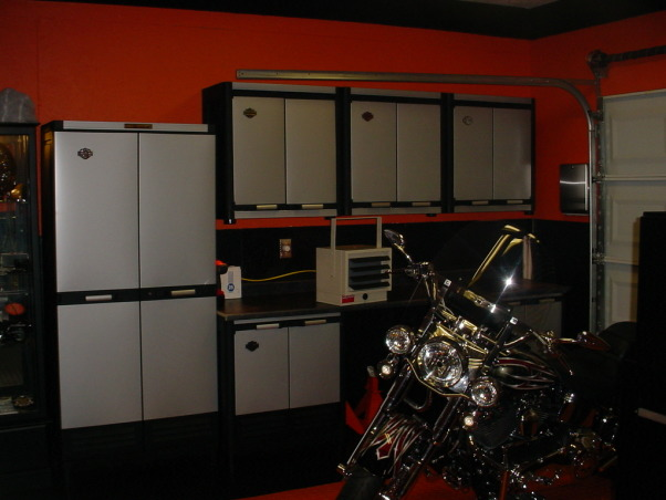 Harley Garage, I installed PVC Diamond Plate Floor Tile Painted walls Black and Orange Decorated in Harley Memorabilia. Harley Pay Phone Professional Poker Table Shelf with Harley Mini Grandfather Clock and so forth. How did I do? , Finally got my cabinets put in and next will be chain link around the bike area.   , Garages Design