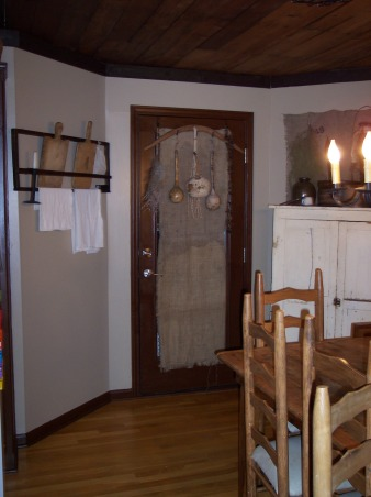 "Country Primitive Dining Room, Here are some pictures of our dining room. I know there is allot to look at...lol But this is the way we like it. I love all the old things....they give me such a ""homey"" feel. We just finished our ""remodel"" on the Dining Room about 6 months ago. Nothing needed to be done but to make this house our home this is what we have done....We add new fixtures boarding up the ceiling & painting the walls & trim. , Oh...we replaced a solid ugly door for this 12 pane door...you probably can' tell it's one though from all my stuff......And YES those are Burlap Curtains.....hehe! Mind works in mysterious ways., Dining Rooms Design"