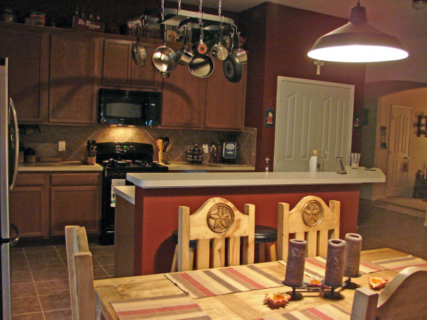 Dr. Pepper kitchen, Based around the theme of Dublin Dr. Pepper home of the 'Pepper' this kitchen was painted red to match the already acquired memorabilia.   To those inquiries...  its a 'Burnished Mahogany' (Behr- Home Depot paint)  satin sheen finish.  : ), Kitchens Design