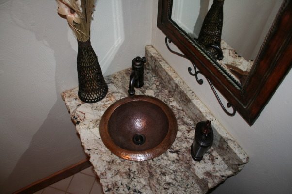 Small Half Bath Remodel, This is our small(very small) half bathroom we recently did over. My brother-in-law made us a great new vanity we picked up a granite remnant(I spotted it while shopping for our kitchen counter top) and we decided to go with a copper sink and an oil rubbed bronze faucet. On the granite we chose to have a chiseled(rock) edge for something different. The bathroom was cold and boring before it now has more warmth and interest. Thanks for checking it out! , , Bathrooms Design