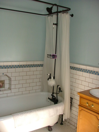 1905 Edwardian Master Bath, Our second bathroom re-do using existing second hand and overstock supplies and a lot of DIY!  This home was built in 1904 without bathrooms. Moved the plumbing around a bit and made this room into a 'period' bath for a family of four from a single-sink no-shower vinyl disaster! Total project was around $5K. All rooms will be updated but period-inspired due to the historical district trends/requirements of this neighborhood., This tub is original to the house but had a simple chrome faucet with no shower riser. We purchased this bronze set and installed it ourselves.  Floors were beat up vinyl and there was exposed piping all along the wall.  Installed the tile ourselves including the niche.  I have great respect for tile layers now!, Bathrooms Design