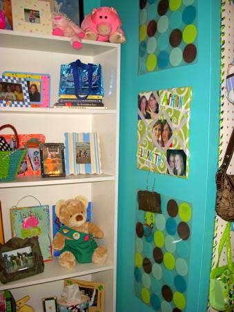 16 year old's bedroom. UPDATED PICTURES!, I redid my room for my 15th birthday. The walls are painted teal (biscay lightened 1 or 2 shades) with a strip of brown above my shelf on one wall. The polka dot comforter is from Target. I ride horses and love them so that really shows through my room like the painting above my bed & my horse frame! My mom & I made my jewelry/ purse boards. My closet doors are completely covered with pictures & words cutout from magazines...I know its pretty crazy but what can i say i'm a teenager!, this is the little wall you see when you enter my room.the polka dot things are actually place-mats that match my comforter from Target., Girls' Rooms Design