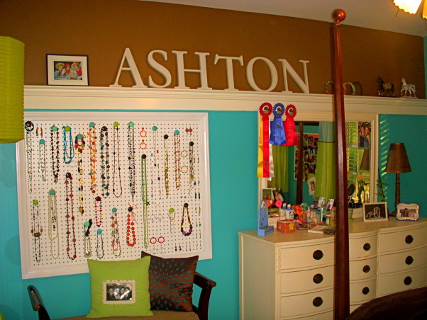 16 year old's bedroom. UPDATED PICTURES!, I redid my room for my 15th birthday. The walls are painted teal (biscay lightened 1 or 2 shades) with a strip of brown above my shelf on one wall. The polka dot comforter is from Target. I ride horses and love them so that really shows through my room like the painting above my bed & my horse frame! My mom & I made my jewelry/ purse boards. My closet doors are completely covered with pictures & words cutout from magazines...I know its pretty crazy but what can i say i'm a teenager!, letters that spell name are from Pottery Barn., Girls' Rooms Design