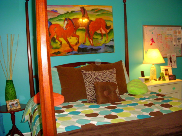 16 year old's bedroom. UPDATED PICTURES!, I redid my room for my 15th birthday. The walls are painted teal (biscay lightened 1 or 2 shades) with a strip of brown above my shelf on one wall. The polka dot comforter is from Target. I ride horses and love them so that really shows through my room like the painting above my bed & my horse frame! My mom & I made my jewelry/ purse boards. My closet doors are completely covered with pictures & words cutout from magazines...I know its pretty crazy but what can i say i'm a teenager!, this picture shows the wall with my bed and my horse painting above it.polka dot bedding is from Target., Girls' Rooms Design