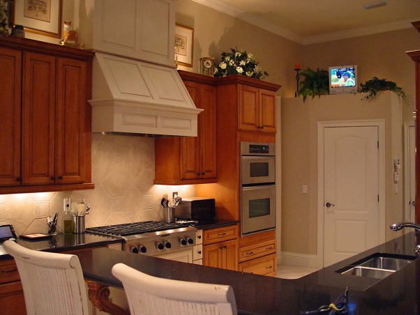 Small but Efficient Kitchen, Thanks to HGTV Angelo & homeowner Andy for choosing my kitchen as an Inspiration Space on RMS the TV show! The galley-style kitchen is part of a big open concept living space. 12 ft. ceiling & tall range hood were a decorating challenge. Video tour and hutch refinishing how-to on my DIY blog at http://www.ratemyfavoritespaces.com. Thanks for stopping by! , Door under the TV is our pantry. I have since added matching white molding to the top of the pantry and it looks more finished. , Kitchens Design