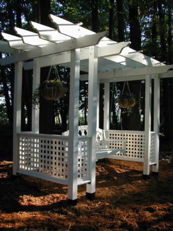 Swing Arbor, This is a swing arbor that I designed and constructed. It sits a top a hill overlooking our large pond. At just the right time of day the sunlight shines through the trees setting a devine glow., Front view, Gardens Design