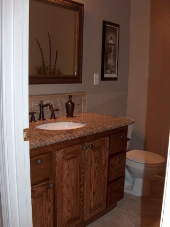 "Before and After Powder Room, This is our downstairs half bath.  Before it had wallpaper and dated finishes.  We added granite undermount sink oil rubbed bronze fixtures and travertine tile.  The flooring is 16"" travertine set on the diagonal.  The paint is divine Latte tinted just a bit darker (to add a bit of contrast from entry way)  Before the bathroom had cherry stianed oak that we re-did in a dark walnut stain.  We did all the work ourselves.  I think its complete but any suggestions?  , Bathrooms Design"