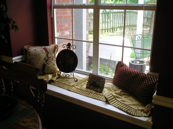 Vineyard Theme Kitchen, I love the deep reds and golds.  Since my living room is also decorated in those colors and open to the eating area of my kitchen it was important that the colors flow., Witrh the window seat  and large window it allows the light to penetrate the eating area.  I have added a couple of decorative pillows in each corner to make it more inviting., Kitchens Design