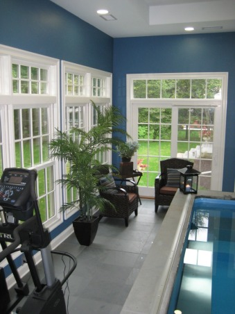 Indoor Pool and Exercise Room, We recently added this new endless pool and excercise room.  There is a partially inground pool which we trimmed with azek and stone.  The floor is grey tile.  We struggled with wall colors then decided to use the chair pillows and a theme and found Ralph Lauren colors to match.  We're really enjoying the space and hope you like it., The ceilings are over 11 feet high the floor is grey tile., Pools Design