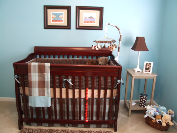 Brody's Room, This room decor was inspired by the prints of one of our favorite artists Stephen Huneck.  We have three dogs and hope that Brody is a dog lover too!, After picking out the Stephen Huneck art prints I wanted to frame I went to a local fabric store and special ordered fabric for the bedding and curtains to match.  My mom sewed it all for me!  And the mobile from Target originally had different fabric on it but I swapped that fabric out with coordinating fabric to match the rest of the bedding.  , Nurseries Design