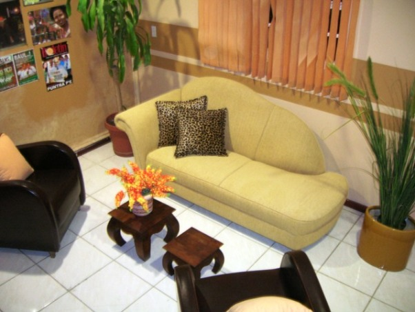 Reception of a Radio Station, Transformer a bright yellow - colored radio station into a welcoming place for clients. Painted the room removed the big cabinet next to the door to give more space brought in new furniture and accents. Created a poster wall as focal point instead of all the spreaded posters over all the walls., , Living Rooms Design