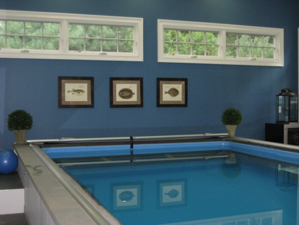 Indoor Pool and Exercise Room, We recently added this new endless pool and excercise room.  There is a partially inground pool which we trimmed with azek and stone.  The floor is grey tile.  We struggled with wall colors then decided to use the chair pillows and a theme and found Ralph Lauren colors to match.  We're really enjoying the space and hope you like it., We did transom windows on outside wall for privacy., Pools Design