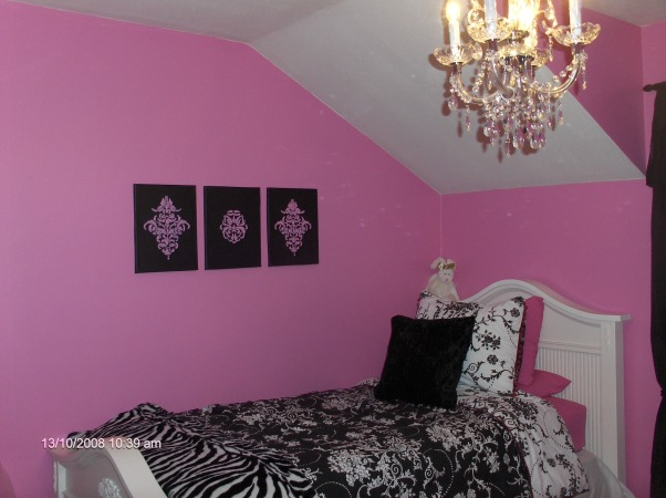 "Chic Bedroom Surprise for 8yr old girl, We've redecorated my daughters' room for a surprise!  She wanted a ""Chi-Chi Frou-Frou Paris Room"" so we went with Hot pink black and white.   This was really a reno on a budget as it cost us less than $350 as we had most of the things from her previously shabby chic room.  She shares her room with her 2 1/2 yr old sister so we made good use of a small space with a trundle bed and little sis sleeps below.  A few things to do...paint closet door paint baseboards & window trim white., Paintings on the wall were home-made...really simple and solved the problem of not being able to find appropriate art for her room, Girls' Rooms Design"