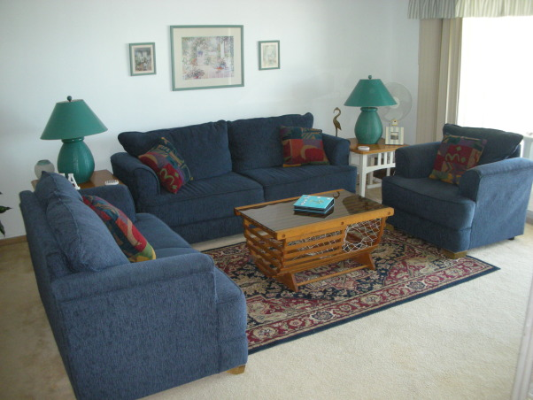 Florida Condo, This is the family condo in Florida. We purchased some used furniture to give the place a much needed update. The dark furniture would not have been our first choice if we purchased new furniture. We'd like to paint the walls. , , Living Rooms Design