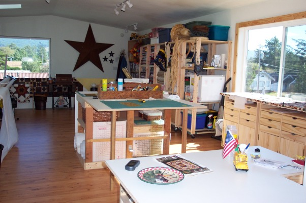 Dream Quilting Studio, Quilting/Sewing/Hobby Space, This table expands to 8 X 4 feet. Plenty of storage for batting in the middle section., Living Rooms Design