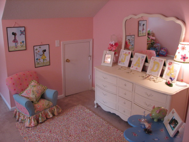 Jada's Big Girl Room, Our daughter just turned 3 so we thought it was time for her to have a big girl room. She loves this space and I am happy we were able to give it to her. It is still a work in progress but this is what we have so far. It is supposed to be butterfly themed but I still have to add some more butterfly accessories. This room is over our garage and used to be our den. We decided to move her room here so that it could double as a playroom. I will update with more pics when the I make changes, I found this dresser on Craigs list for $150. I painted it to match the bed. The rug came from Target., Girls' Rooms Design