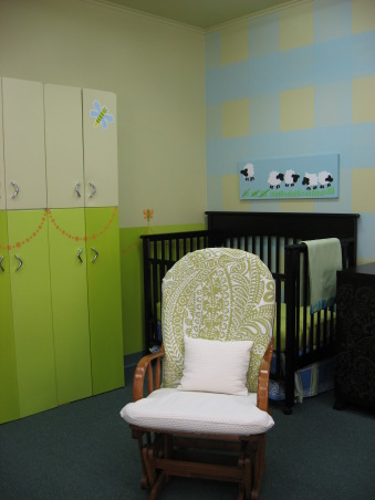 Church Nursery, We calmed down a 1960s intense yellow to a soothing palette of Sherwin-Williams Saffron Thread Cay Frolic Hep Green and Ancestral Gold. Ancestral Gold was our base and neutral color. The greens were used to make the stripes on two of the walls. Cay was used to create the plaid walls using glaze. The long floor-to-ceiling curtains are for the privacy of the mothers and sleeping babies., On the left are two metal kitchen cabinets that were previously in the room. We revamped them with paint and tried to blend them into the wall. They are used for diaper bag and coat storage. The rocking chairs were recovered to match. The cribs were purchased from Target and fitted with custom sheets and bedskirt., Nurseries Design