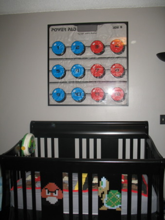 Super Mario Brothers, Classic 80's Super Mario Brothers theme! Includes hand painted canvas of the last level of Super Mario Brothers a hand made quilt of a pixeled Mario and Super Mario wall decals! Lots of work and love!, Framed Power pad above crib with Goomba and Turtle decals, Nurseries Design