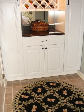 Laundry Room Converted to Pantry Space, When we moved into our home this space was originally the laundry room/mud room between the garage and kitchen.  We needed more storage so we installed these floor to ceiling cabinets with a nice wine rack.  We added a mirror backslash to add depth and the counter matches the kitchen.  Also added a glass door to extend the kitchen space visually., , Kitchens Design