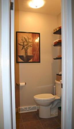 Small 5 x 5 Powder Room, Our main floor power room was stuck in the 70s.  We modermized the space by replacing everything except the walls.  Added Slate floor tile mocha spacesaver vanity black/silver framed mirror pendant lighting quiet ceiling fan/light combo brushed chrome fixtures 6 panel door and new molding for a fresh clean look., Bathrooms Design