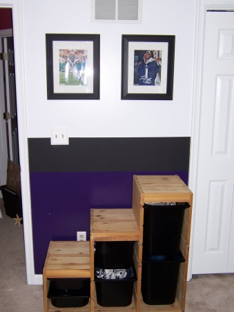 Ravens Football Room!, Being huge Baltimore Ravens fans when it came time to re-do our sons room there was no other option  for us! The Raven purple is on the bottom black in the center and white on top.The black paint in the middle is actually chalkboard so our son can keep scores and stats on the wall. We were going for the running scoreboard look.All the prints and the jersey are signed by men who play for the best team!My husband made the 6 square wall unit. , , Boys' Rooms Design
