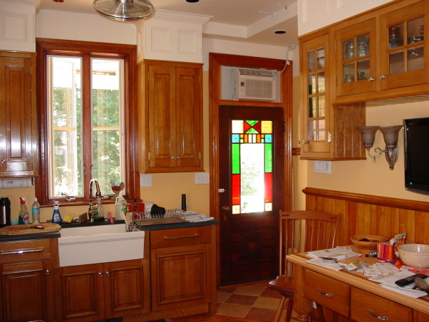 Late Victorian Butler's Pantry Kitchen, I completed my DIY kitchen about a year ago with the fabrication of the soapstone countertops. It was a 15 month project working evenings and weekends but it was sooooo worth it. The kitchen is in a 1900 addition to my 1850 house. The kitchen when I moved in was barely functional and it toolk many years to figure out how to fit all the appliances around the two windows and six doors in the room., I bought this ca. 1880 door on ebay stripped it took out the glass refinished and reglazed it. , Kitchens Design