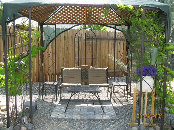 Did it ourselves park-like setting, Our backyard was nothin' but dirt 6 years ago. We have s-l-o-w-l-y added trees shrubs rock and accents to make it our favorite place to hang out  whenever the weather permits., A shady rest stop., Yards Design