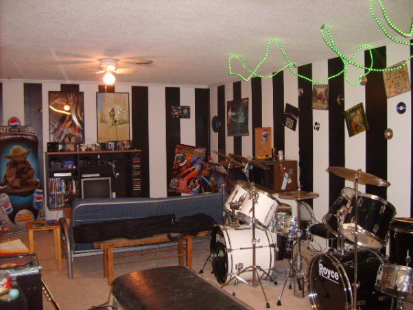Music/Game Room, This is a combo Music game excerise room.(L shaped)  My son and his friends love it., View from Music room side.  Black & White stripes.  Green rope lights over the drums. Decorated with old album covers and CD discs.  (Plan on changing the ceiling fan)  Game room side decorated in Star Wars., Boys' Rooms Design