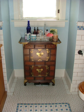 1905 Edwardian Master Bath, Our second bathroom re-do using existing second hand and overstock supplies and a lot of DIY!  This home was built in 1904 without bathrooms. Moved the plumbing around a bit and made this room into a 'period' bath for a family of four from a single-sink no-shower vinyl disaster! Total project was around $5K. All rooms will be updated but period-inspired due to the historical district trends/requirements of this neighborhood., This was another craigslist find - holds bath goodies and all the stuff a girl needs.  I made a stained glass window to replace the old window above but have to rebuild the window frame.  Don't know how to do that part yet., Bathrooms Design