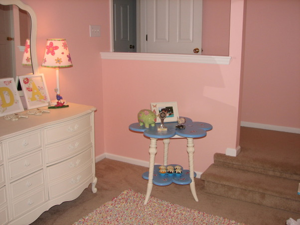 Jada's Big Girl Room, Our daughter just turned 3 so we thought it was time for her to have a big girl room. She loves this space and I am happy we were able to give it to her. It is still a work in progress but this is what we have so far. It is supposed to be butterfly themed but I still have to add some more butterfly accessories. This room is over our garage and used to be our den. We decided to move her room here so that it could double as a playroom. I will update with more pics when the I make changes, This is the view of the doorway from the window seat.  I found the table in the corner at Tuesday Morning. It was broken and thrown away in the back. I offered $50 for it and had it fixed and painted to match the room. Im either going to put a dollhouse on it in the future or a small television. The toddler chair faces this direction. I plan to put a framed chalkboard on that wall behind the stairs. The space is too narrow for furniture and I do not want to just hang another picture. , Girls' Rooms Design