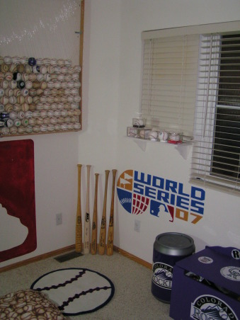 "Colorado Rockies baseball room, I created this Colorado Rockies baseball bedroom for my 11 month old son but my 5 year-old  daughter liked it so much she has decided to trade him for a while.  , 3 of the bats you see in the corner were given to me in trade for a ""commemorative"" home run ball that I caught during an actual Colorado Rockies game.  , Boys' Rooms Design"