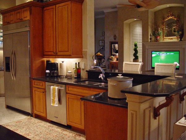 "Small but Efficient Kitchen, Thanks to HGTV Angelo & homeowner Andy for choosing my kitchen as an Inspiration Space on RMS the TV show! The galley-style kitchen is part of a big open concept living space. 12 ft. ceiling & tall range hood were a decorating challenge. Video tour and hutch refinishing how-to on my DIY blog at http://www.ratemyfavoritespaces.com. Thanks for stopping by! , I can enjoy the big TV in the great room but the refrigerator ""half wall"" keeps the kitchen out of sight when company comes in the front door. I LOVE this feature! , Kitchens Design"