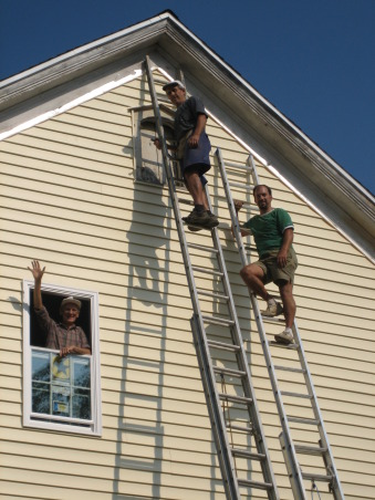 Our renovated 100 year old farm house, The last piece of siding being applied. Uncle Alex helping out from the window. If it wasn't for him and my dad's fearlessness of heights I don't think this would have been done by us. , Home Exterior Design