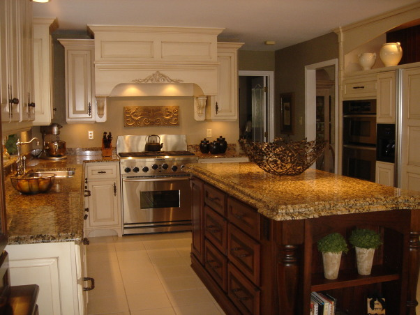 "HGTV RMS Inspiration Room - my new kitchen photos, My kitchen is one of the inspiration rooms on episode #208 of the Rate My Space Show. Thank you Angelo, Jillian and HGTV for choosing my kitchen as an inspiration room. It was quite an honor and a lot of fun being on the show. I renovated my kitchen a couple of years ago. We went from an outdated 1980's kitchen to this. The original kitchen had pickled oak cabinets with white formica countertops. I wish I had taken a ""before"" picture to show you. The change is remarkable., Both the painted and stained cherry cabinets have a glazed finish. They were made by a wonderful cabinetmaker to my specifications. Appliances are Kitchen Aid. Granite is Giallo Vicenza. Wall paint is by ICI the color is Palm Springs Tan. My kitchen is not very large. It looked much smaller prior to the renovation. The ceilings are only 8' so removing the soffits over the wall cabinets and taking the cabinets to the ceiling has helped make it feel taller.          , Kitchens Design"