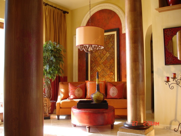 another view of Ricky and Jeffs entry lounge, warm and inviting, Thank you guys for your great comments! An indian textile is framed as a piece of art.The arch is a faux keystone material and applied to the wall the inside area are various shades of red venetian plaster. The columns are drizzled with copper paints and a subtle moorish stencil design. the walls are a soft golden faux the floor is a antiqued  edge travertine and the drum was made to fit over the existing fixture.tRicky  Vacha    SW FLorida       , Living Rooms Design